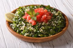 Tabbouleh salad closeup in a bowl on the table. horizontal Stock Image