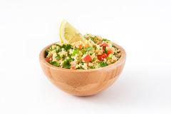 Tabbouleh salad with couscous and vegetables. Isolated on white background royalty free stock images