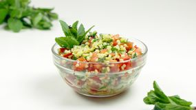 Tabbouleh salad in a Glass Bowl on a White Background. stock photos