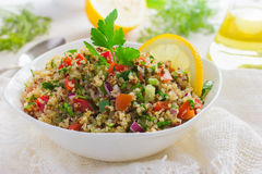 Tabbouleh salad with quinoa, parsley and vegetables. On white background Royalty Free Stock Image