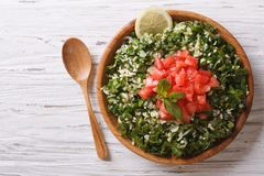 Tabbouleh salad in a wooden bowl. Horizontal top view Stock Images