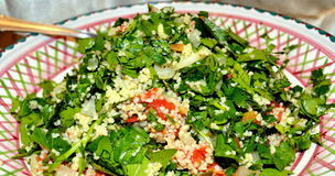 Tabbouleh. Traditionally made of tomatoes, finely chopped parsley, mint, and onion, and seasoned with olive oil, lemon juice, and salt Stock Photo