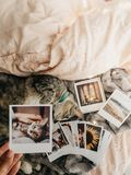 Tabby cat lying down in bed and several retro photos. Tabby cat lying down comfortably in bed and several retro photos royalty free stock photos