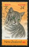 Tabby cat. NEW ZEALAND - CIRCA 1983: stamp printed by New Zealand, shows Tabby cat, circa 1983 royalty free stock photo