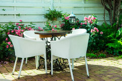 A tabel. With chairs at the reargarden Royalty Free Stock Photos