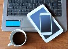 Tabela com tabuleta, telefone e PC Fotografia de Stock