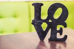 Tabela de madeira do amor da palavra fotos de stock