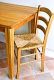 Tabela e cadeira de madeira Foto de Stock Royalty Free