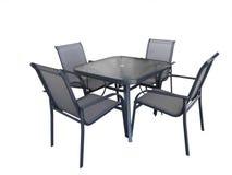 Tabela e cadeiras de vidro ao ar livre Fotos de Stock