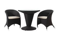 Tabela e cadeiras do Rattan imagens de stock