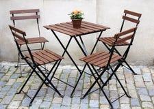 Tabela e quatro cadeiras Foto de Stock