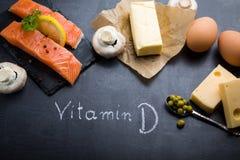 Tabela preta da ardósia com os ricos do produto na vitamina D Fotografia de Stock Royalty Free