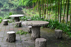 Tabelas e tamboretes de pedra Imagem de Stock