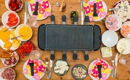 Tabell med raclette arkivbilder