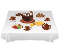 Tabell med sötsaker Arkivbild