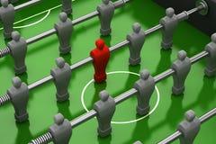 Tabella di Foosball con il giocatore rosso Fotografie Stock Libere da Diritti