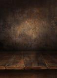 Tabella di legno con la vecchia parete Immagini Stock Libere da Diritti