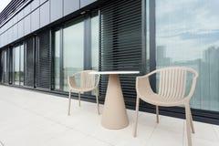 Tabella e sedie Fotografia Stock