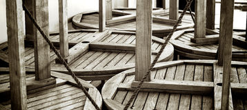Tabelle di legno circolari impilate Immagine Stock