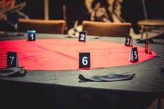 Tabelle für das Spielen der Mafia Stockbild