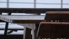 Tabelle und Bank im Freien Regen und Hagel Langsame Bewegung stock video footage