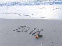 Tabellen 2018 auf dem Sand Stockfoto