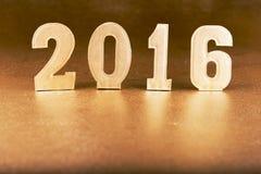 Tabellen 2016 auf einem Goldhintergrund Lizenzfreie Stockbilder