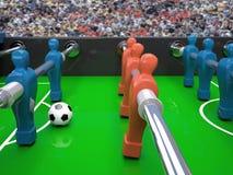 Tabellfotbollleksak och fotbollboll Arkivbilder