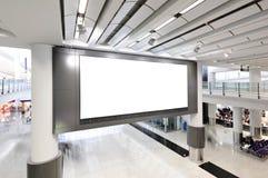 Tabellone per le affissioni in bianco dell'interno Fotografia Stock
