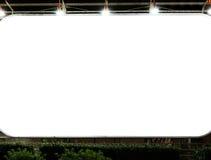 Tabellone per le affissioni in bianco nella notte immagini stock