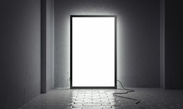 Tabellone per le affissioni dell'interno luminoso in bianco con la struttura nera accanto alle pareti grige, rappresentazione 3d illustrazione di stock