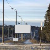 Tabelloni per le affissioni vuoti nella città di inverno Fotografie Stock Libere da Diritti