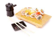 Tabelltidsbeställningar av sushi Royaltyfri Bild