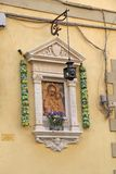 Tabernacle - niche with an icon on the wall of a house in floren Stock Images