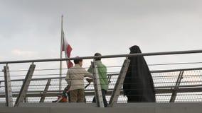 Tabiat bridge, people walking in modern architectural landmark structure