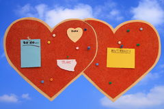Tablón de anuncios en forma de corazón Fotos de archivo