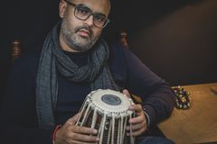 Tabla and Cajon - Indian and Peruvian drums used to make fusion percussion music. Cajon is a relatively new drum like percussion instrument originating from stock photos