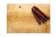 Tabla de cortar con la salchicha Imagen de archivo libre de regalías