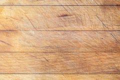 Tabla de cortar de madera con las lineas horizontales fondo Imagen de archivo