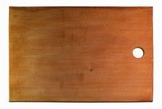 Tabla de cortar de madera en un blanco Fotos de archivo