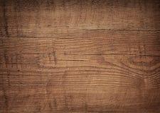 Tabla de cortar de madera rasguñada del marrón oscuro Madera Fotos de archivo