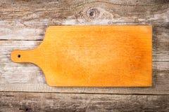 Tabla de cortar vacía del vintage en fondo de la comida Foto de archivo