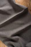 Tabla de madera con el mantel oscuro Imagen de archivo libre de regalías