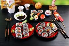 Tabla del partido del sushi Fotos de archivo libres de regalías