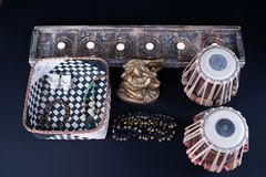 Tabla drums next to Lord Ganesha statue. stock image