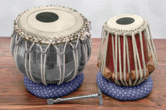 Tabla drums. Set of traditional tabla drums on wooden surface Royalty Free Stock Photo