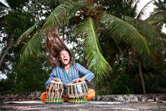 Tabla player with hair up Royalty Free Stock Photo