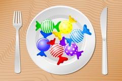 Tabla puesta con los caramelos Imagen de archivo