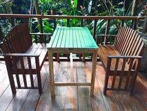 Tabla y sillas Imagen de archivo libre de regalías