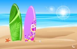 Tablas hawaianas en la playa Imagenes de archivo